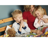 Picture of a mother and two kids praying